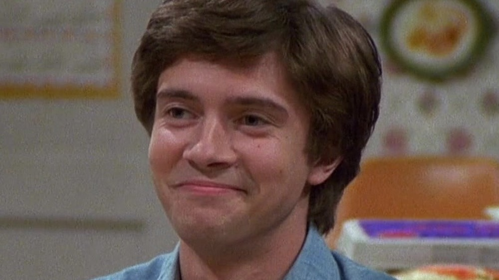 Eric Forman with a self-satisfied grin