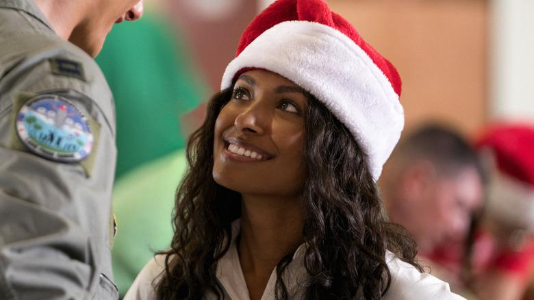 Kat Graham dons a Santa hat as Erica in Operation Christmas Drop