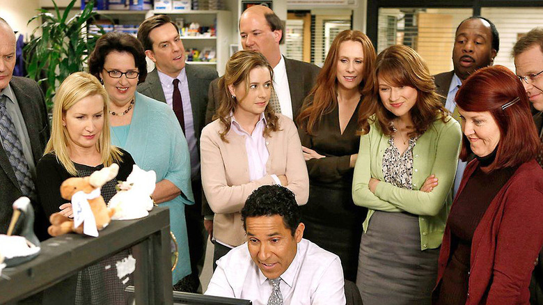 The cast gathers around in the final season of The Office