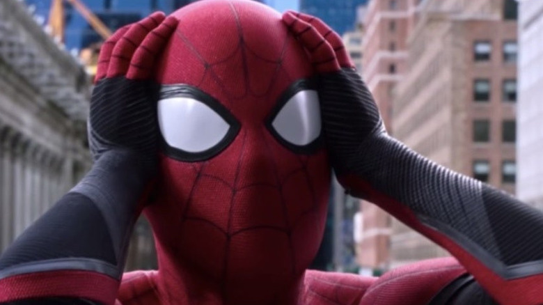 Spider-Man holding his head