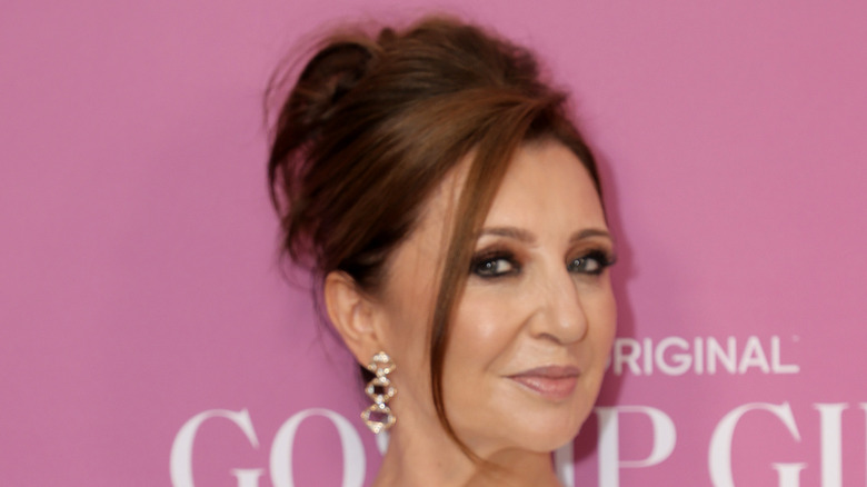 Donna Murphy posing at event