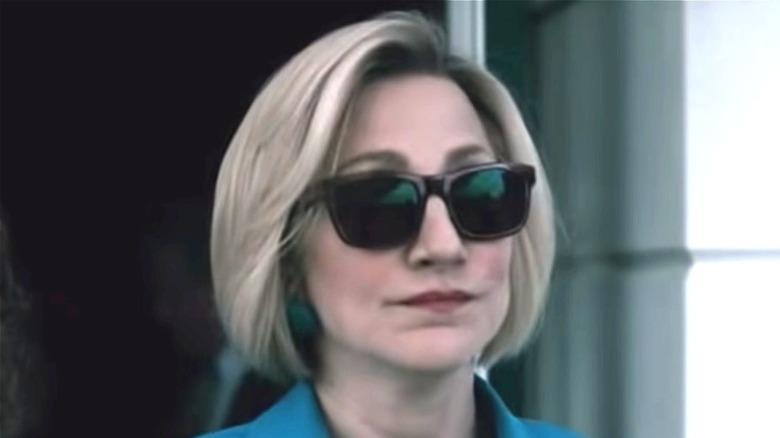 Edie Falco as Hillary Clinton