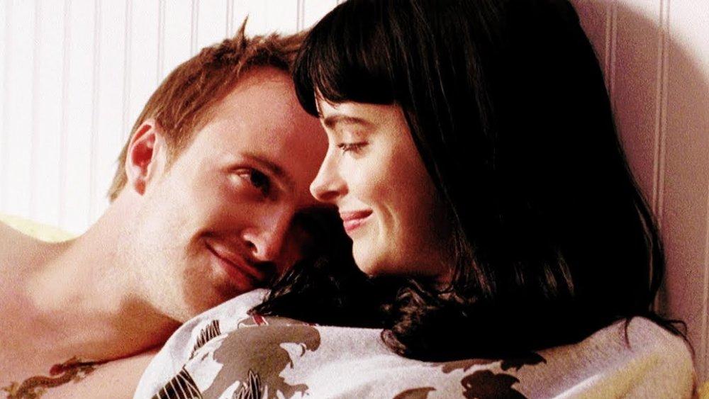 Aaron Paul as Jesse and Krysten Ritter as Jane cuddle in bed in Breaking Bad