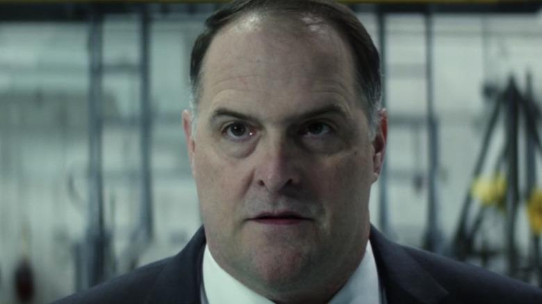 Dodd speaking in a hangar