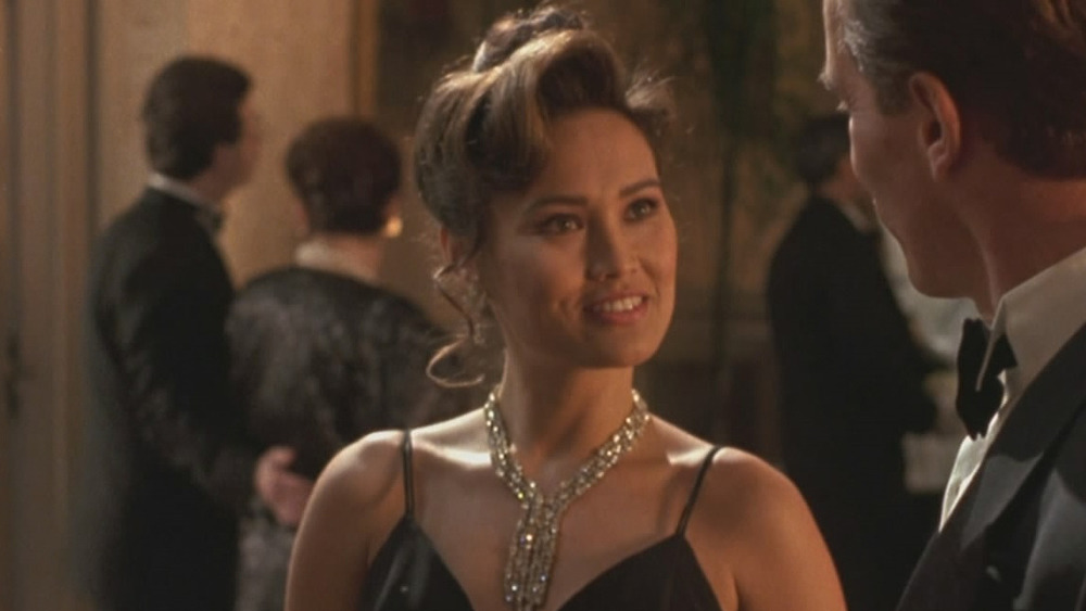 Tia Carrere as Juno Skinner in a black dress in True Lies