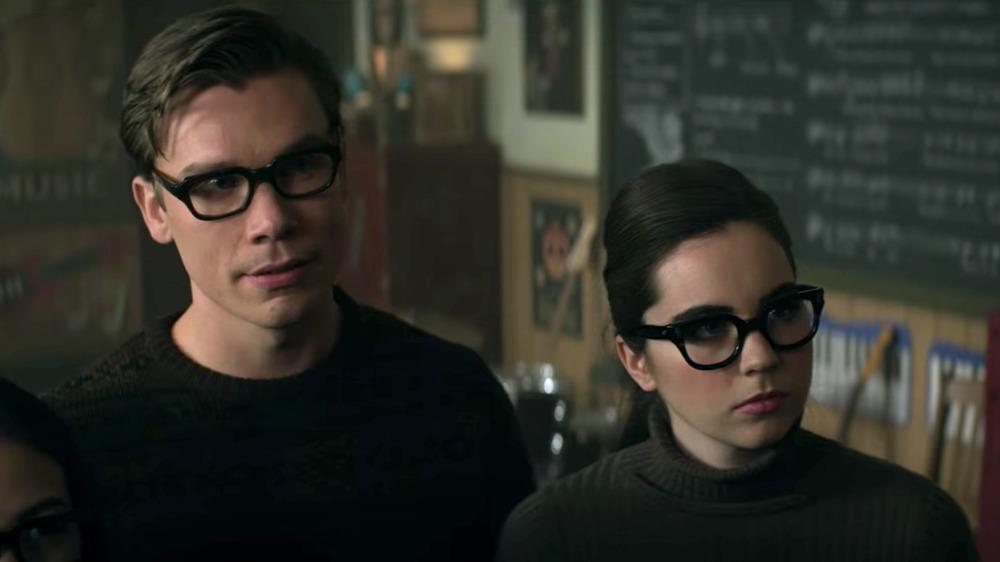 Sarah Desjardins as Katie looking intimidating in glasses