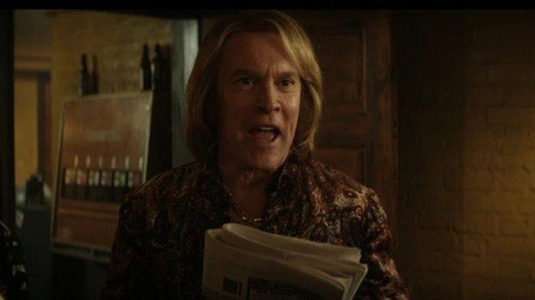Doug Weston holding a newspaper