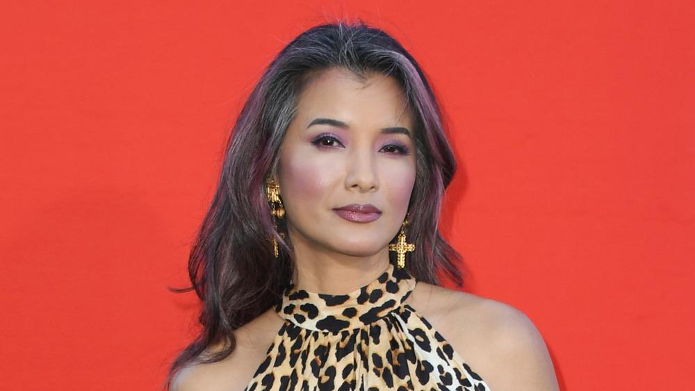 Kelly Hu in a leopard print dress
