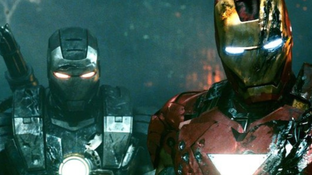 Don Cheadle as James Rhodes/War Machine and Robert Downey Jr. as Tony Stark/Iron Man in Iron Man 2