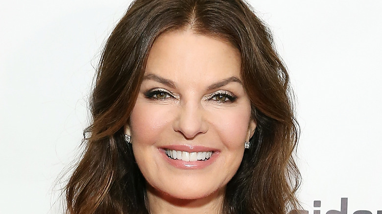 Sela Ward smiling for cameras at a premiere