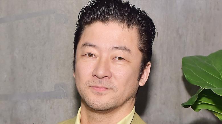Tadanobu Asano looking at the camera