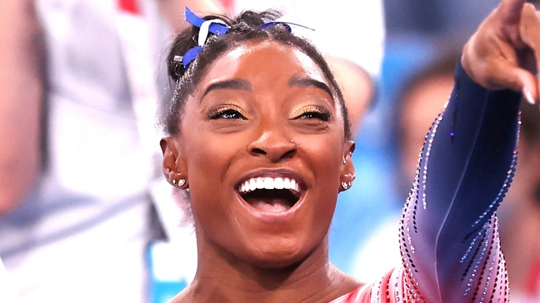 Simone Biles Smiling and Pointing