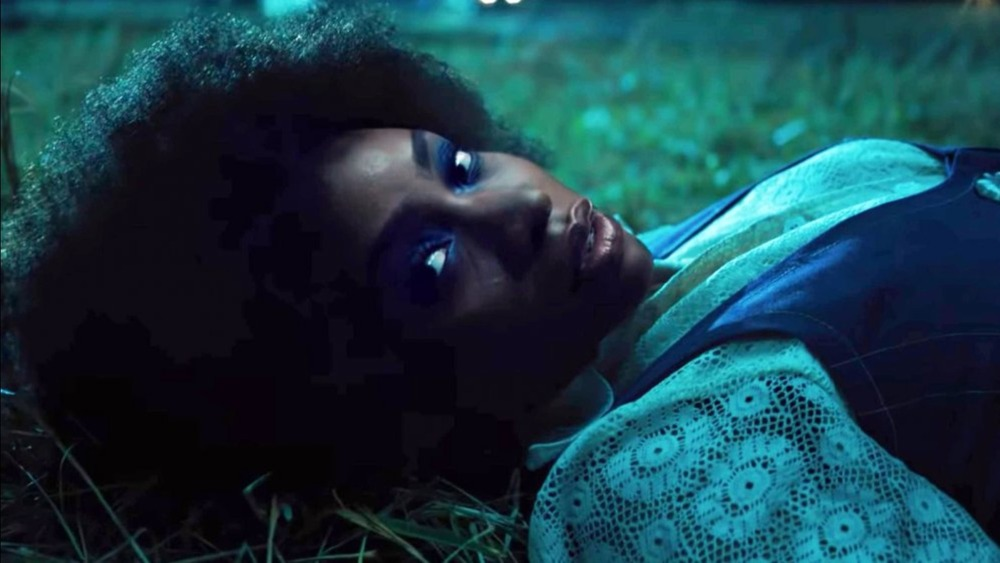 Teyonah Parris on the ground
