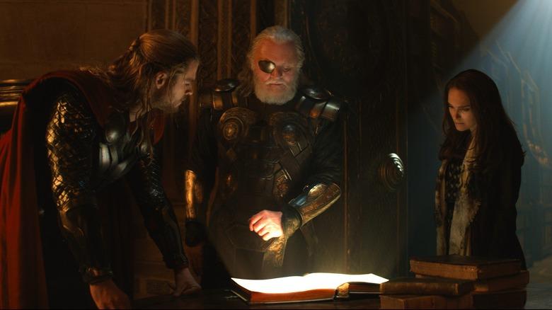 Chris Hemsworth, Anthony Hopkins, and Natalie Portman in Thor: The Dark World