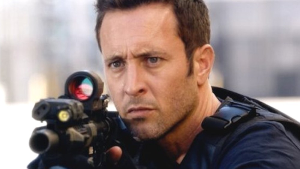 Steve McGarrett holding a gun