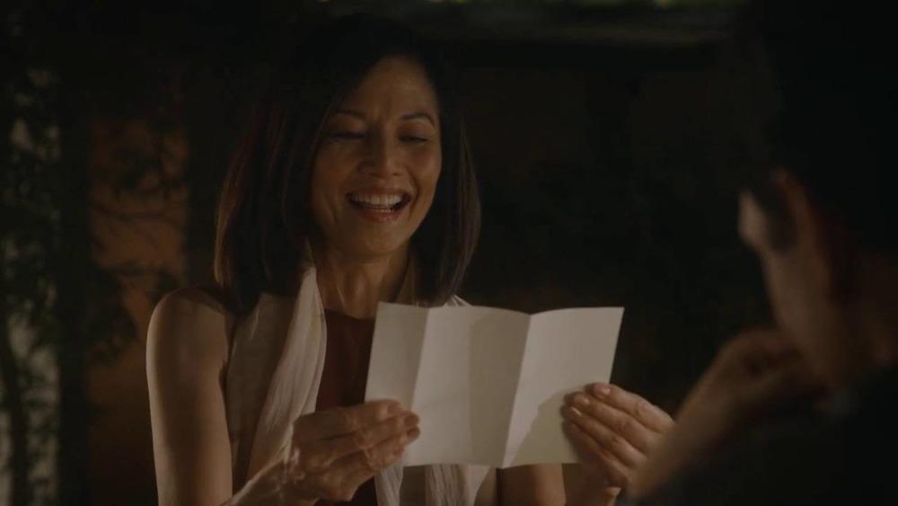 Kumiko reading a letter