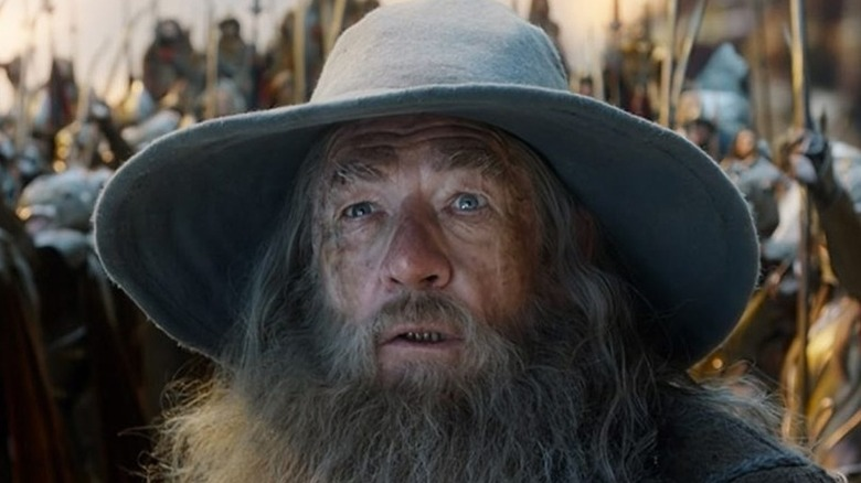 Gandalf looks up in shock