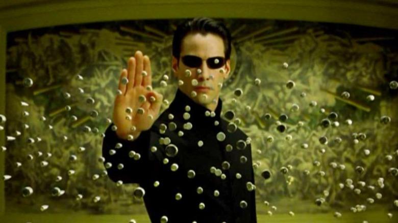 Neo stopping bullets mid-flight