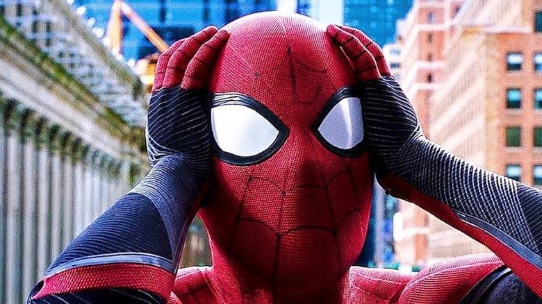 Spider-Man holding head in shock