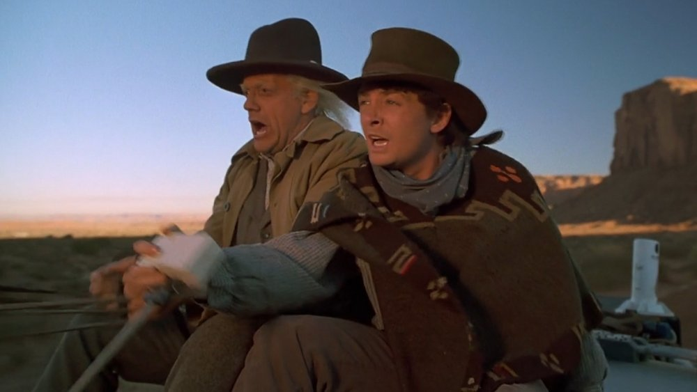 """Christopher Lloyd as Emmett """"Doc"""" Brown and Michael J. Fox as Marty McFly in Back to the Future III"""