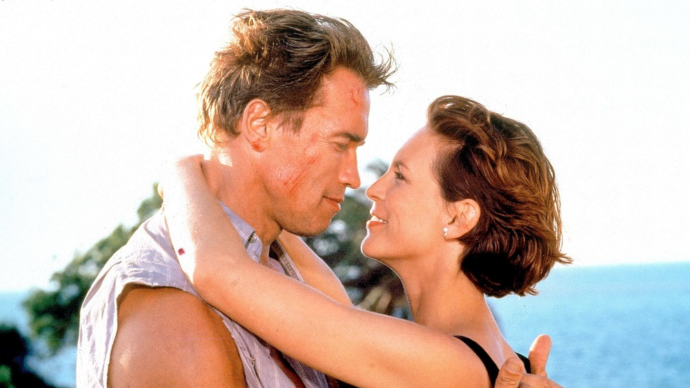 Arnold Schwarzenegger and Jamie Lee Curtis embracing