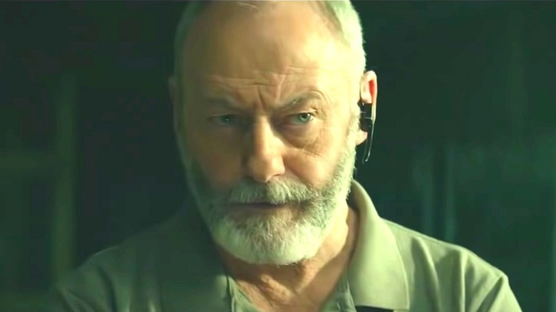 Liam Cunningham with eyebrow raised in 'The Vault'