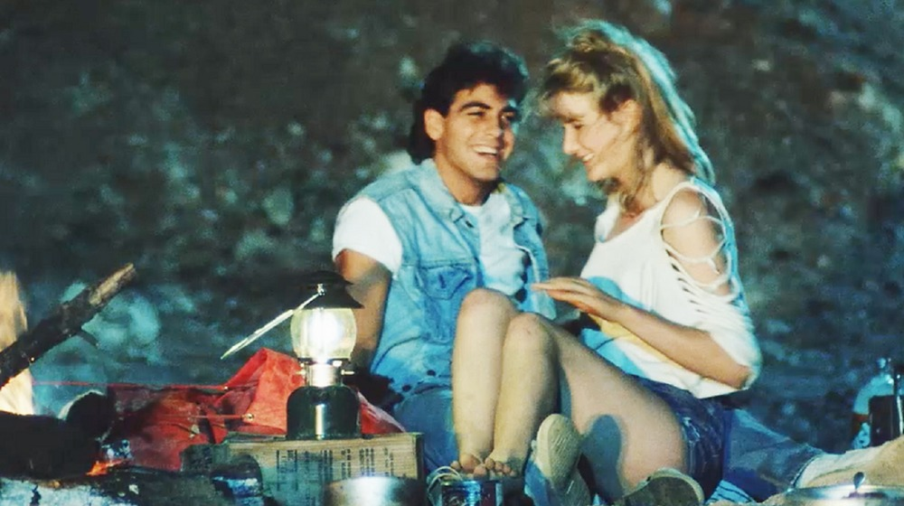 George Clooney and Laura Dern in Grizzly II: The Predator