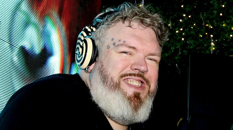 Kristian Nairn wearing headphones