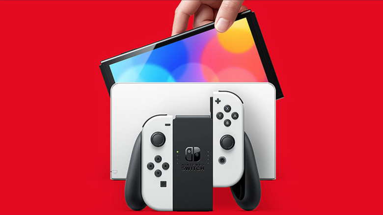 Nintendo Switch OLED red background with white dock and Joy-Cons