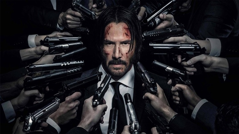 John Wick surrounded by lots of firepower