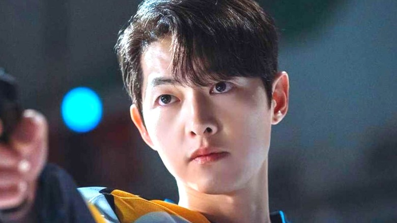 Song Joong-ki as Vincenzo pointing gun