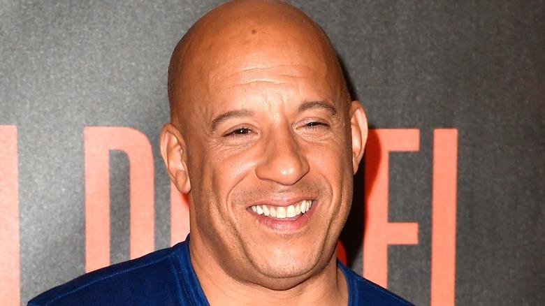 Vin Diesel smiling bloodshot red carpet