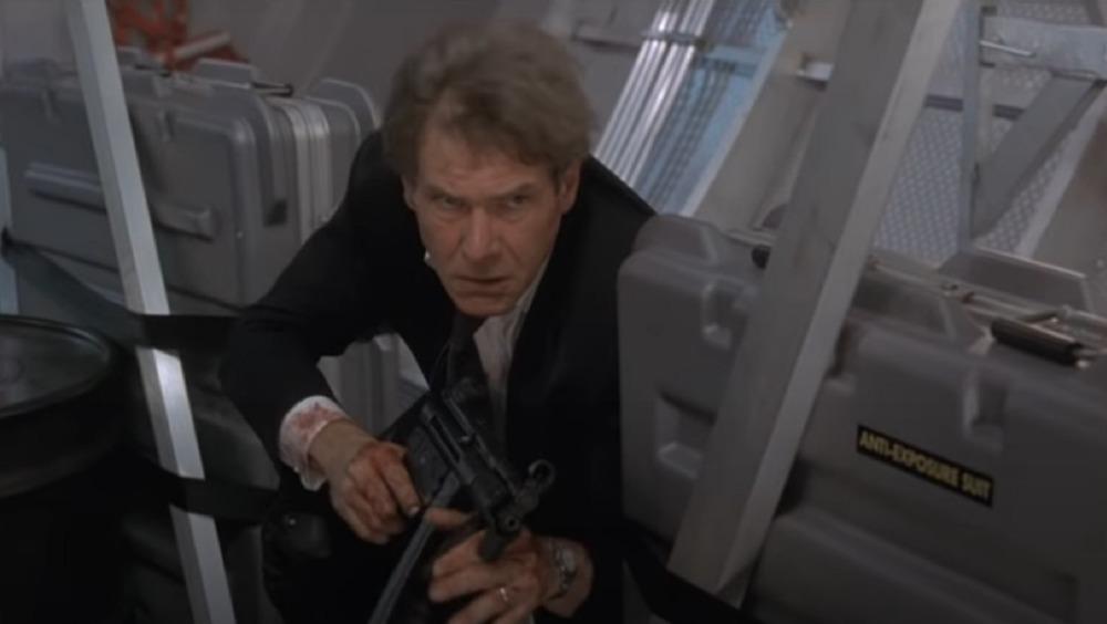 President Marshall with machien gun
