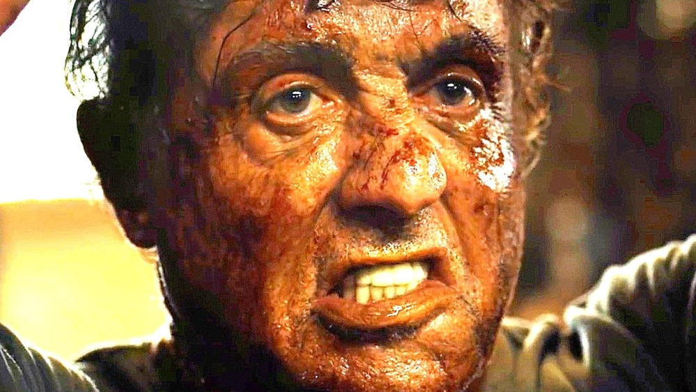 John Rambo grimacing, covered in blood