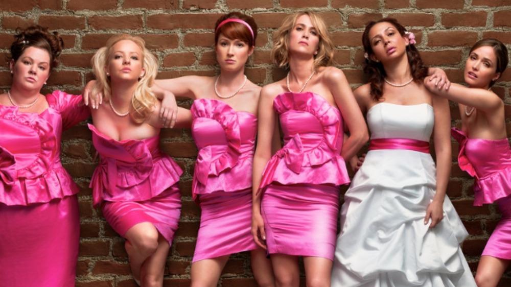 Bridesmaids cast in wedding attire