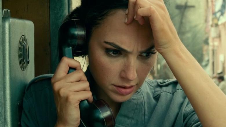 Gal Gadot as Diana holding phone