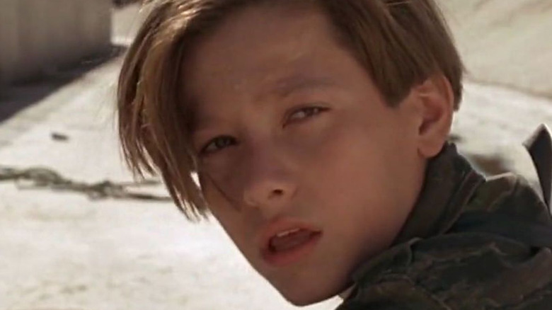 Young John Connor looking behind himself
