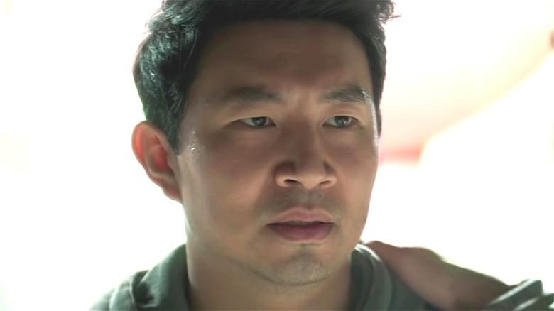 Simu Liu as Shang-Chi in green shirt