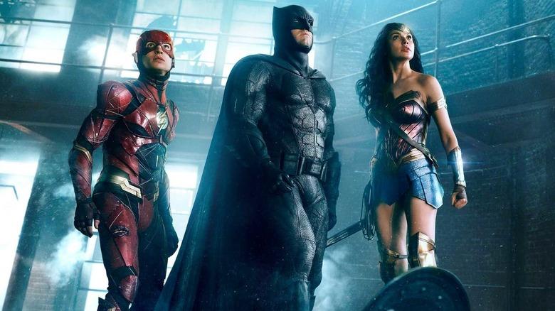 Batman, Flash, and Wonder Woman in costume